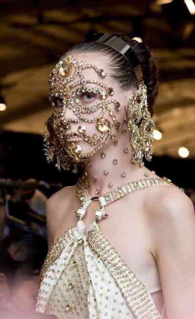 Model is pictured with gold diamante facial jewellery.