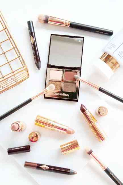 Flat lay of Charlotte Tilbury's makeup brand collection.