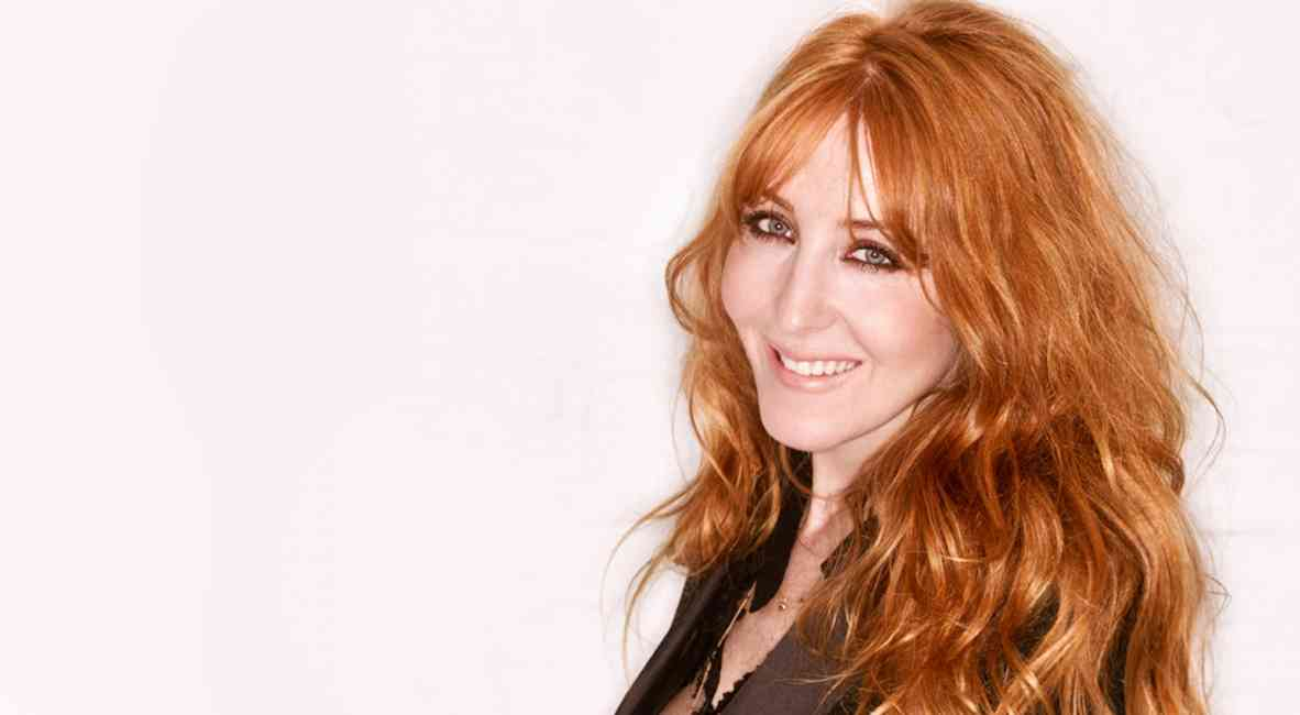 Portrait of Charlotte Tilbury radiating beauty and confidence.