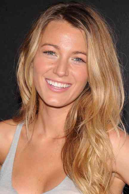 Blake Lively showcasing her natural glowy and bronzed complexion with her beautiful smile.