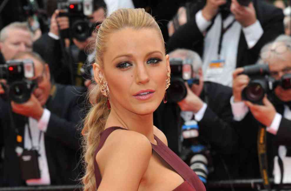 Blake Lively burgundy dress at Cannes 2014, showcasing her signature red carpet smoky eye.