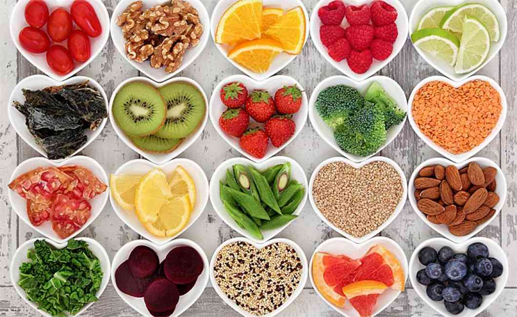 Flat lay of fruit, vegetables, nuts and grains that are high in fibre to aid digestion and increase good gut bacteria