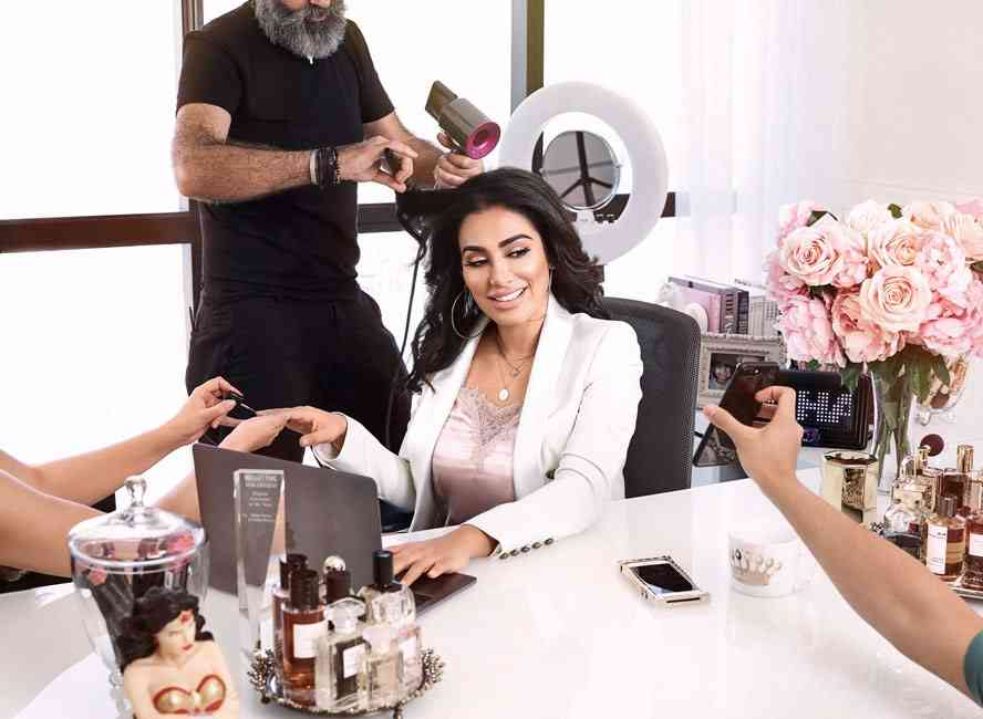 Huda Kattan being manicured and treated like the queen of the beauty empire that she is.