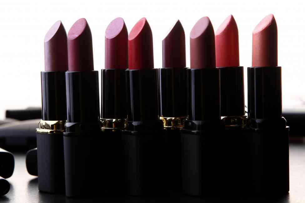 Arrangement of berry coloured lipsticks.