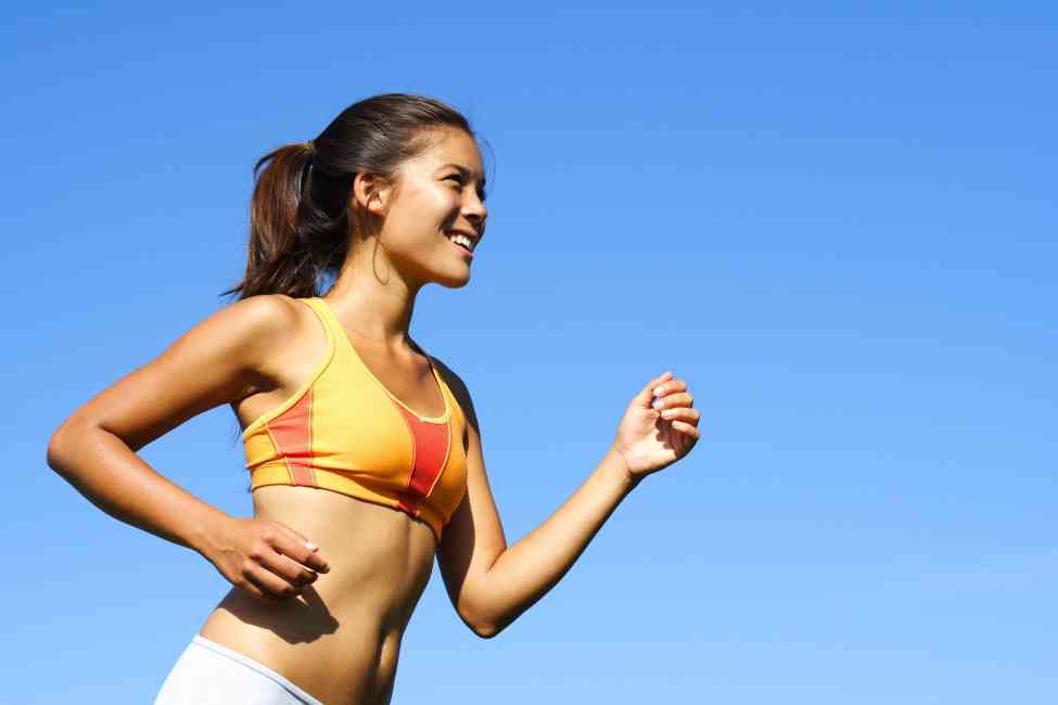 Fit and healthy woman running.