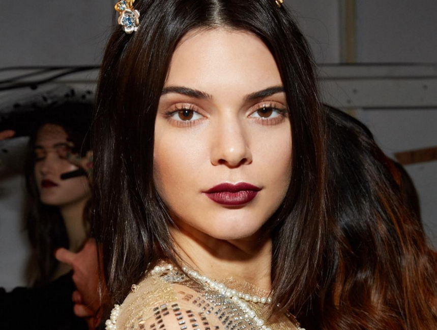 Rich burgundy lips on model, backstage at NYC fashion week