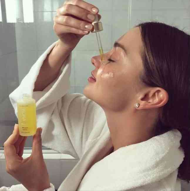 Founder Miranda Kerr using her Kora Organics products while getting ready for Met Gala in New York on May 1, 2017.