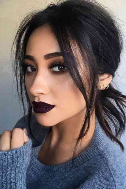 Celebrity Shay Mitchell rocking a dark and mysterious makeup look.