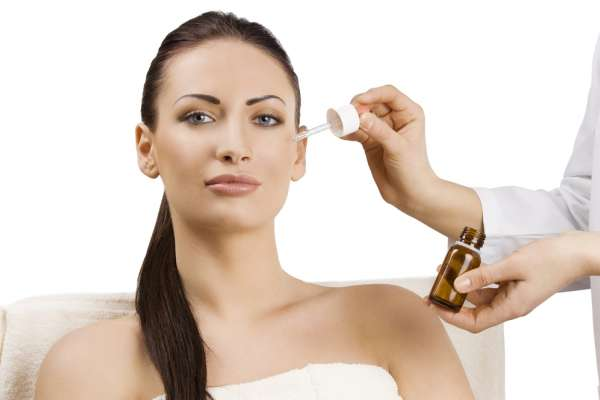 Customer applying serum to skin