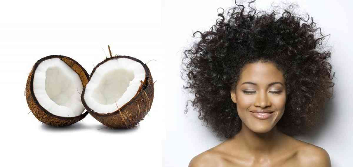 Woman with curly hair pictured beside a halved coconut.