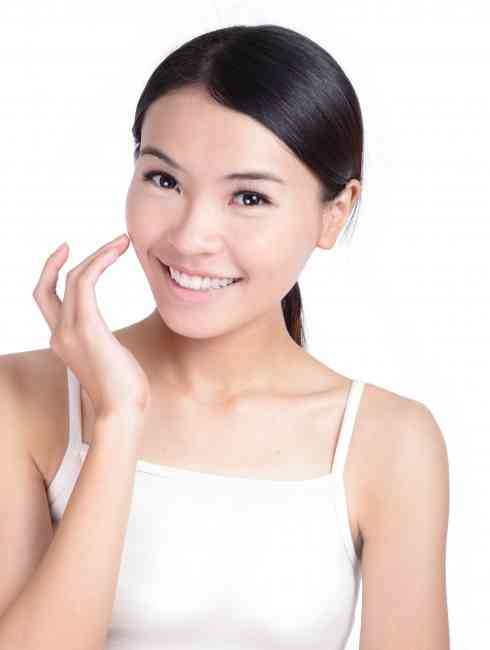 Girl after applying concealer to her face showing off her radiant complexion.