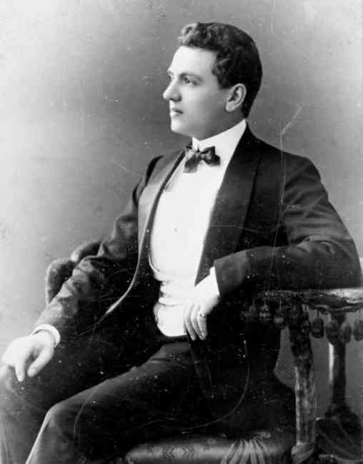 Black and white portrait of Ernest Beaux sitting on a chair.