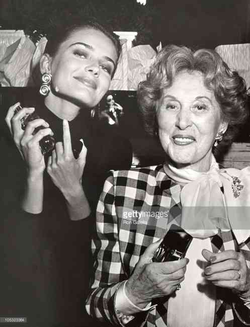 Stock image of Estée Lauder next to a model with her products.