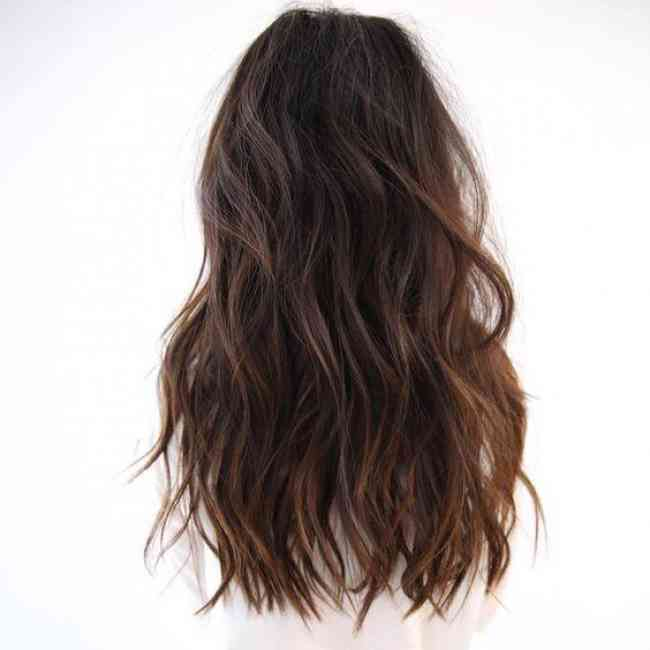 Brunette hair with beachy waves.