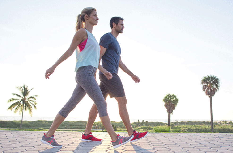 Man and woman power walking for exercise.
