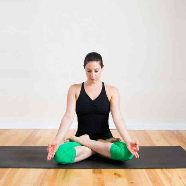 Woman relaxing in a meditation sitting position.