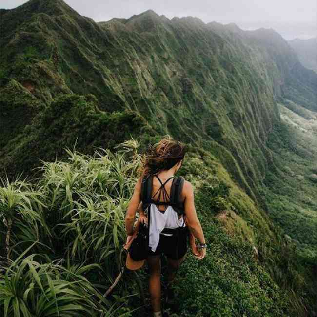Woman hiking in beautiful mountain landscape.