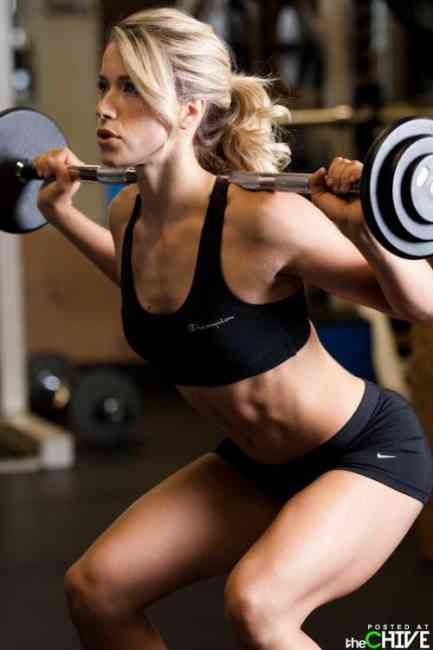 Woman deadlifting weights.