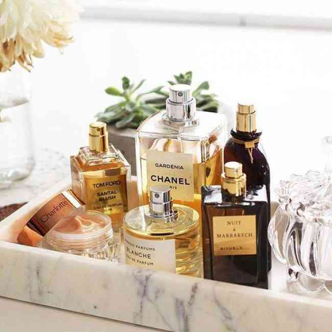 Chanel, Tom Ford, Byredo fragrances on a tray