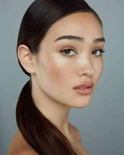 Girl with glowing skin by foundation coverage