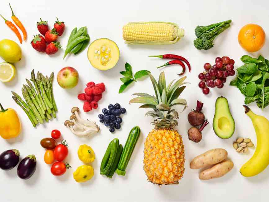 Flat lay of a wide range of fruits and vegetables as part of a balanced diet