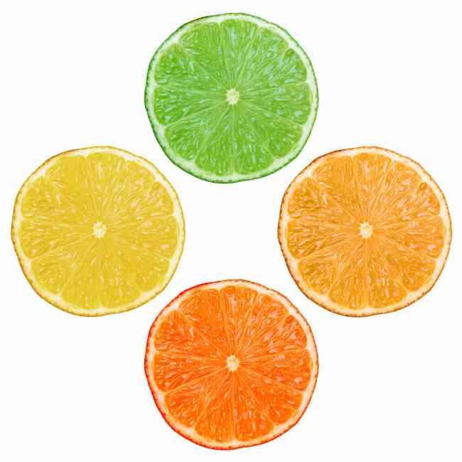 Citrus diamond arrangement of lemon, lime, orange and grapefruit.