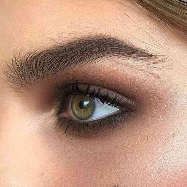 Green eye with brown/hazel smoky eye makeup.