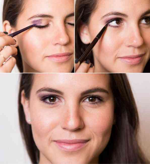 Woman applying liner to create the effect of smaller eyes appearing larger.