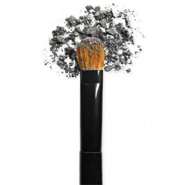 Grey powder eye shadow on a flat shader brush.