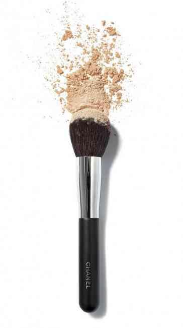 Powder spilling off a brush